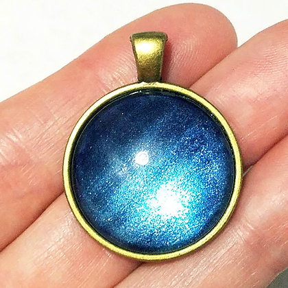 Gold Toned Shimmering Blue Pendant with Black Cord Necklace