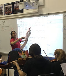 Ms. Wilkins in class, teaching.