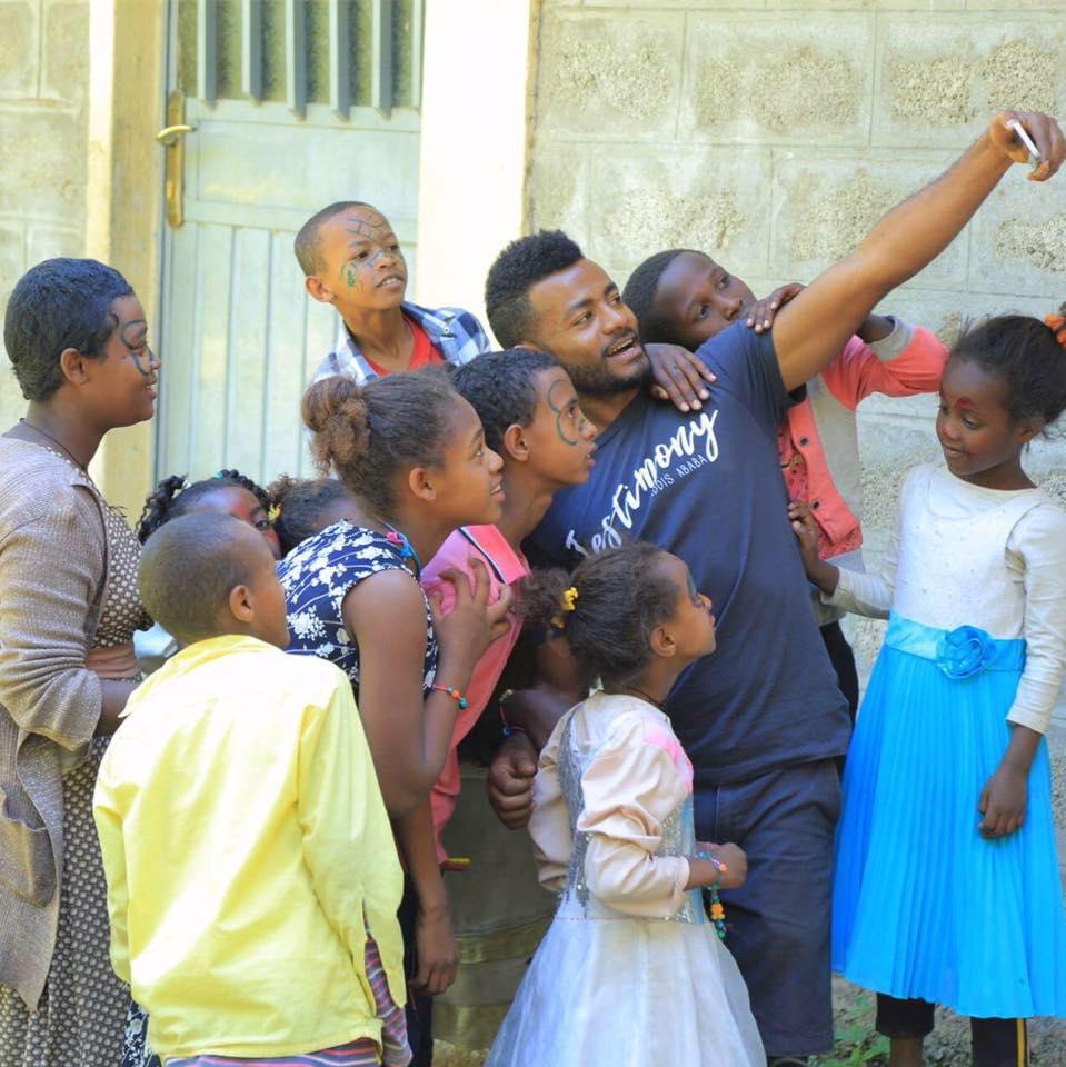 testimony gadisa with kids.jpg