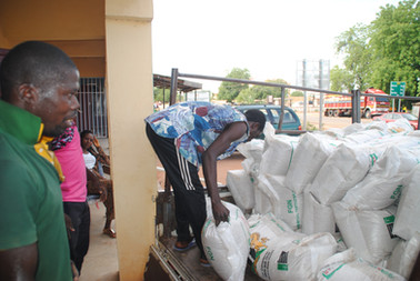 Farmers Collecting Fertilizer