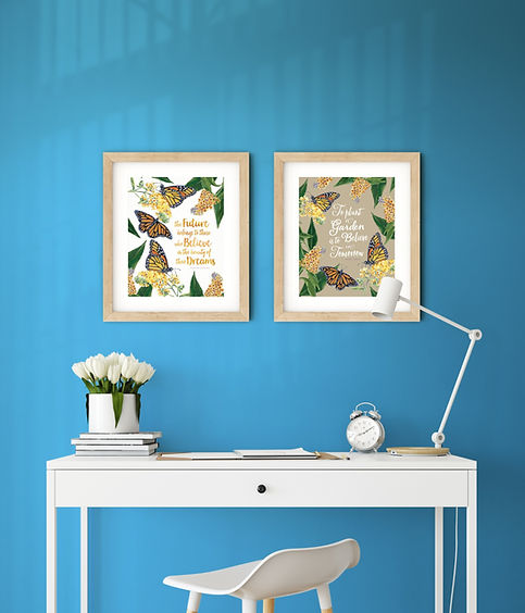Framed monarch butterfly art prints with inspiration quotes on a blue wall