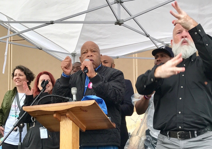 Congressman John Lewis speaks outside The Center for Civil and Human Rights during the Atlanta March for Social Justice and Women on January 21, 2017.