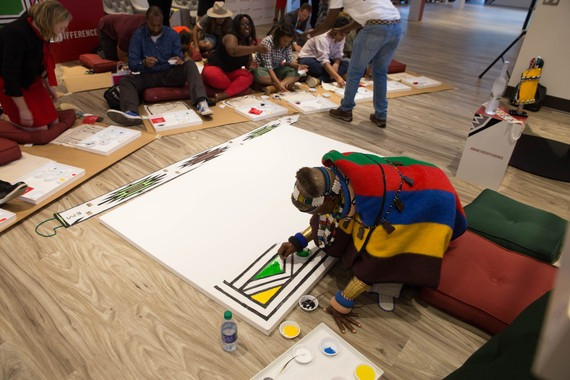 Esther Mahlangu paints at the Woodruff Arts Center in Atlanta. Photo courtesy of Mission.