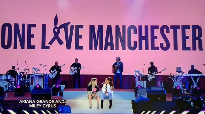 """Ariana Grande and Miley Cyrus perform """"Don't Dream It's Over"""" at the One Love Manchester concert in Manchester, England on June 4, 2017."""