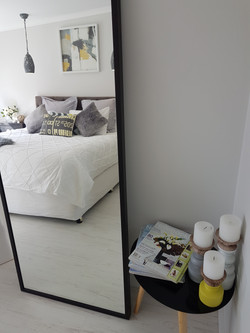 Dressing mirror with hanging space