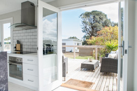 Stunning french doors opening onto back deck