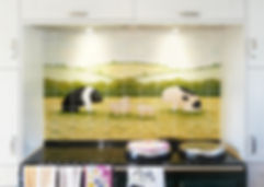 Hand painted Sitting Pigs and piglets, shown above an Aga as a Kitchen splashback
