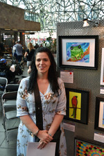 Justine Martin with her painting 'Terry the Tree Frog'