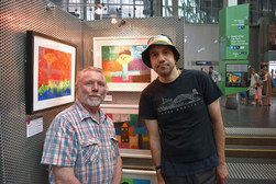 One of our artist George with a purchaser of his drawings.