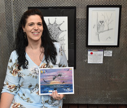 Justine with her drawing 'Just a little Owl'