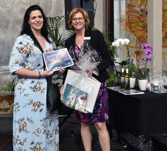Miranda Bruyniks presenting Justine Martin with the 'Disability Services Commissioner' award for her drawing 'Just a Little Owl'