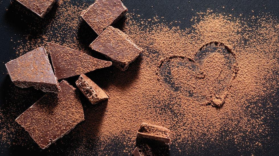 broken-chocolate-bar-on-black-background
