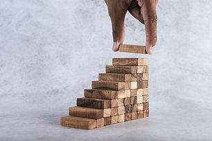 stacking-wooden-blocks-is-risk-creating-