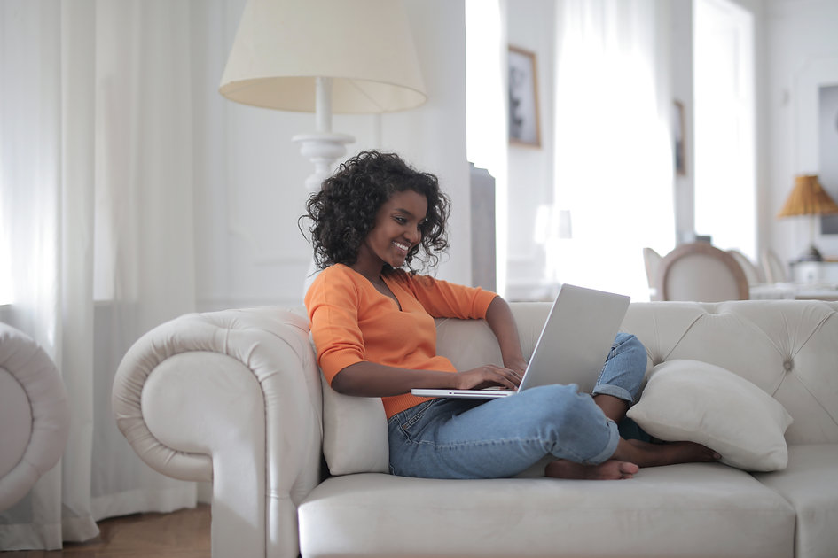 Canva - Woman Sitting on White Couch Usi