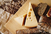 sliced-cheese-on-brown-table-top-821365-