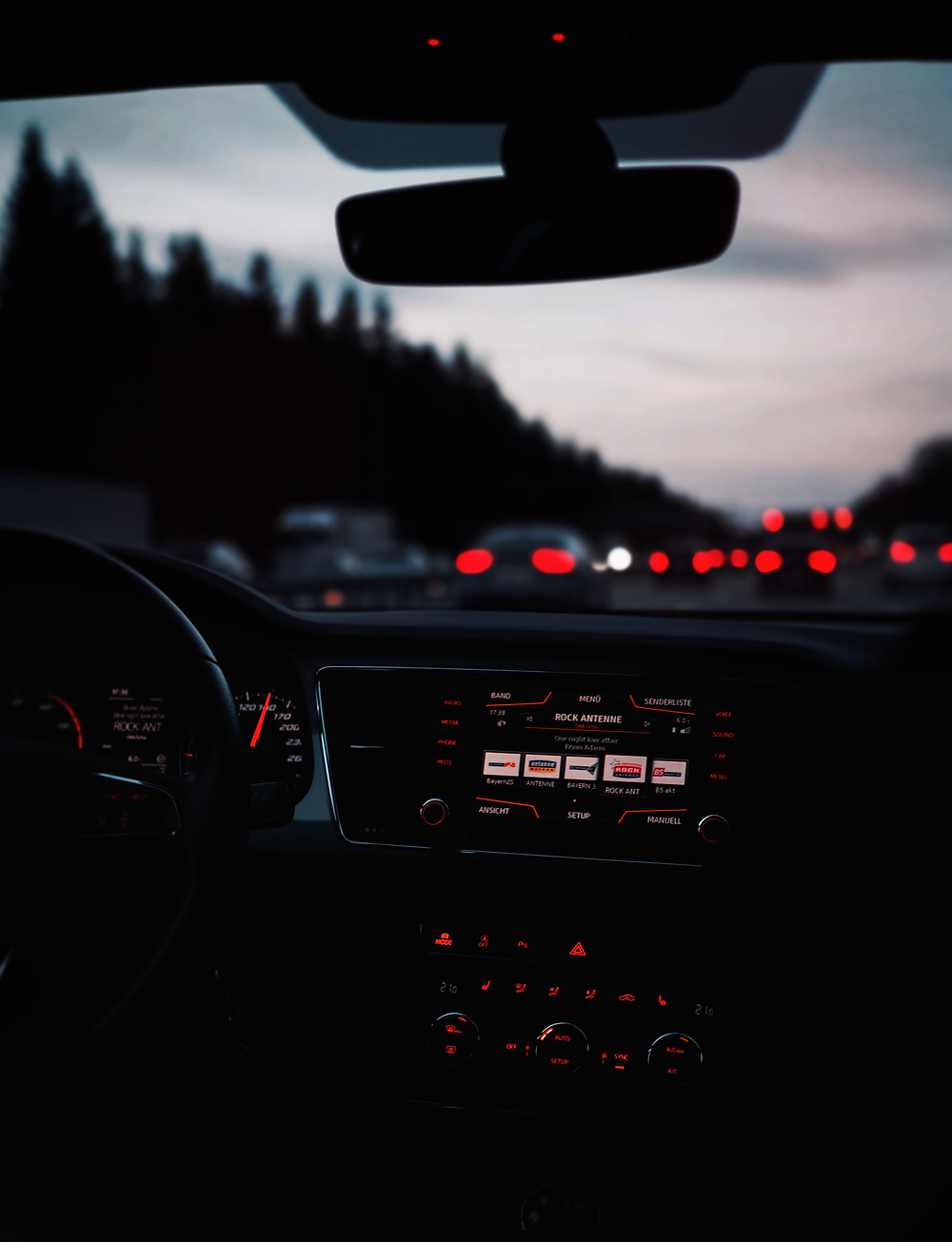 Interior of vehicle on highway at dusk