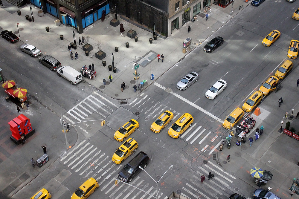 Aerial view of vehicles crossing intersection