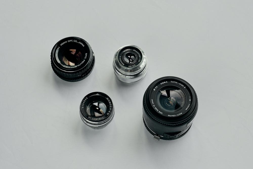 Camera lenses on a white background.