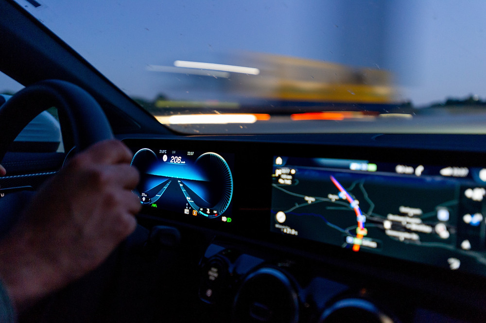 Vehicle Driving with lit up dashboard.