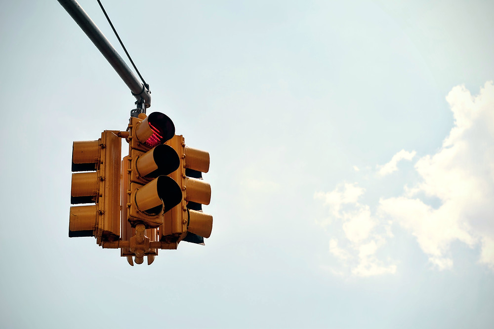 Red light against backdrop of blue sky