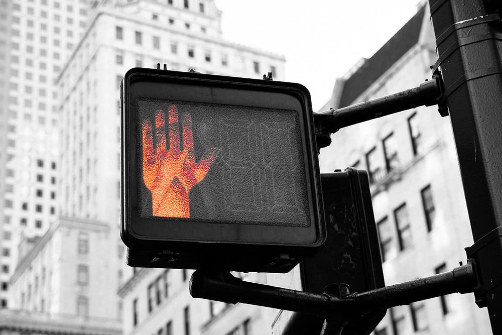 Pedestrian Stop Light in City