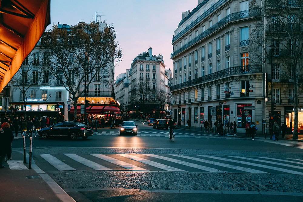 Evening shot of street in busy Parisian neighborhood