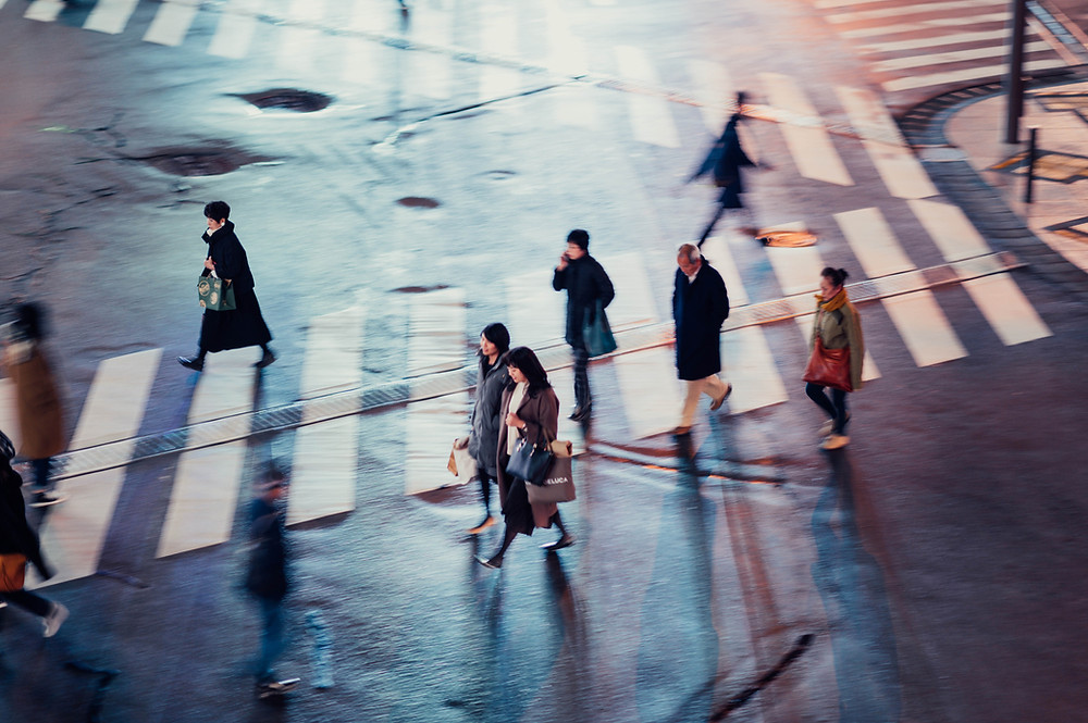Pedestrians crossing the road at intersection.