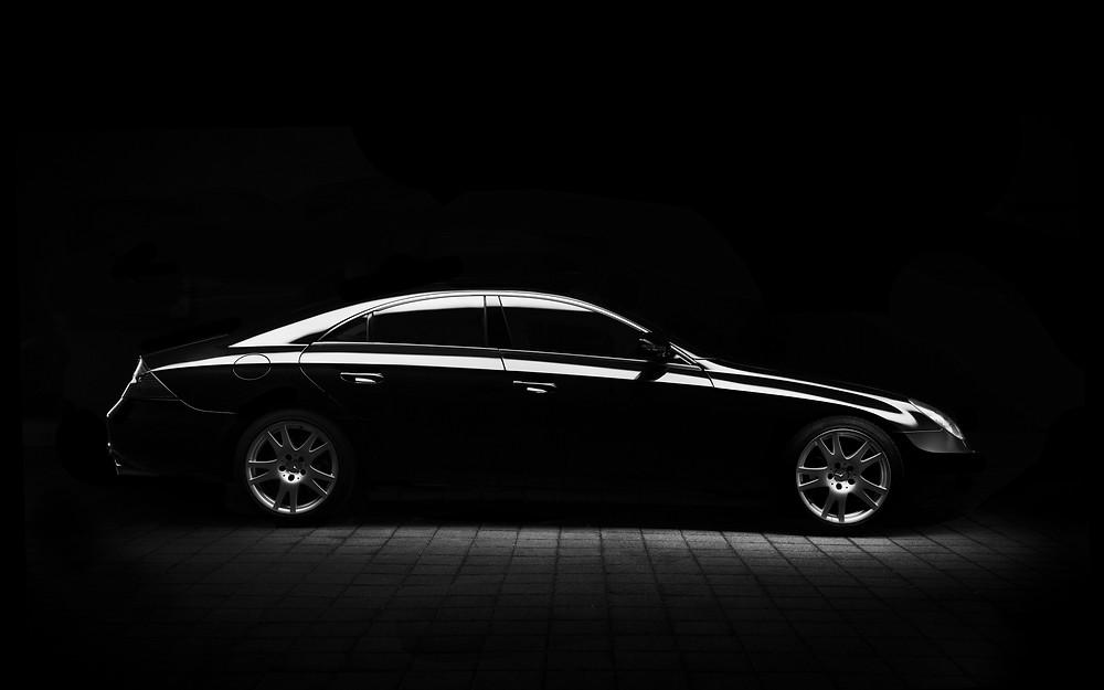 Black Car in Dimly Lit Room