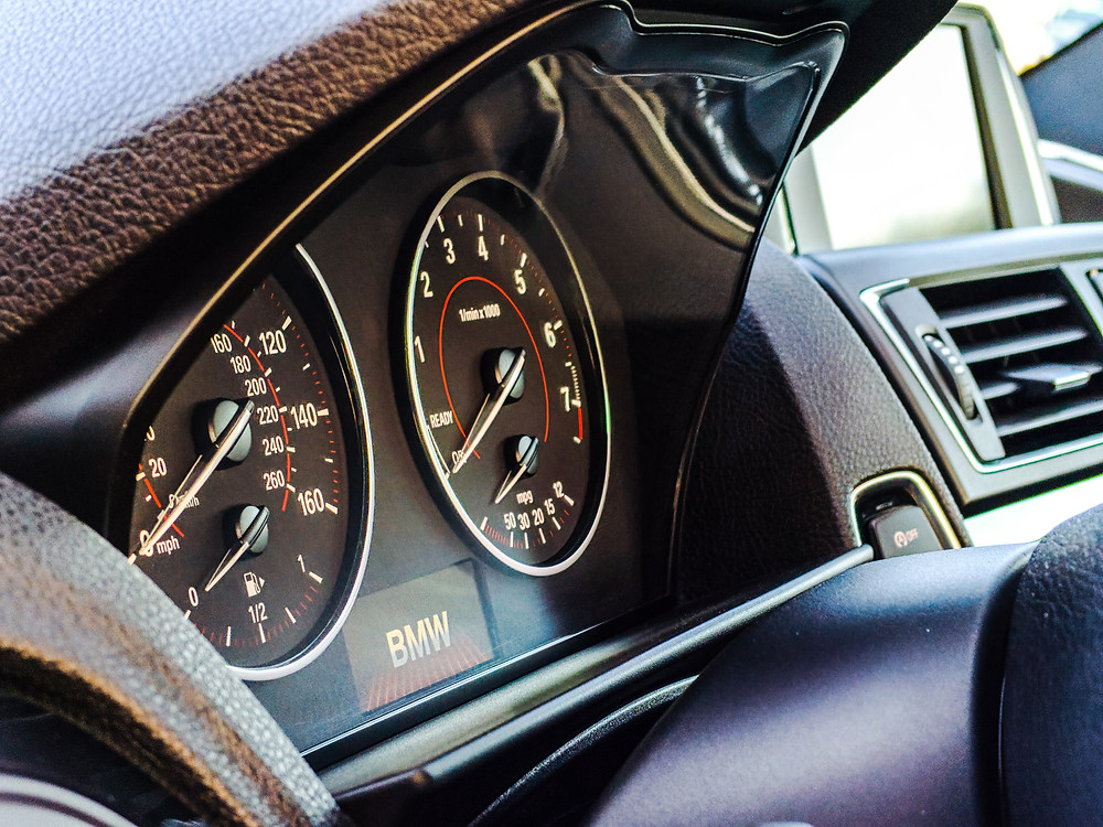 Interior of vehicle, close-up of speedometer.