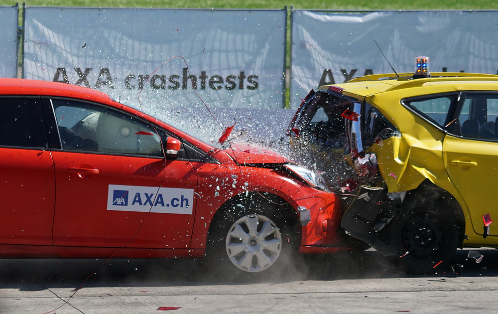 Two cars crashing into each other during crash test