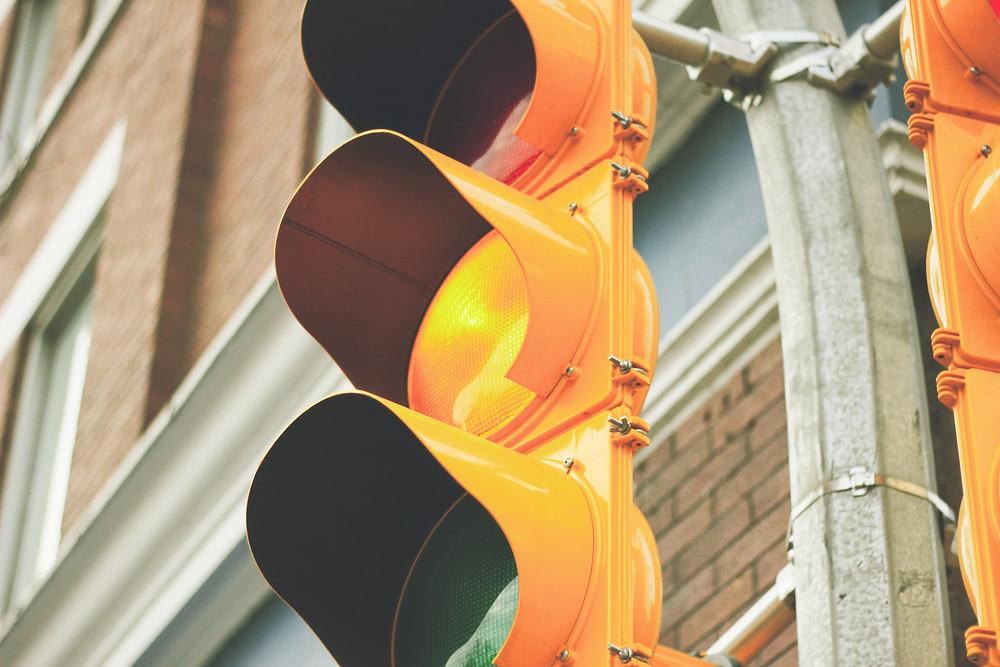 Close-up of traffic light turned yellow