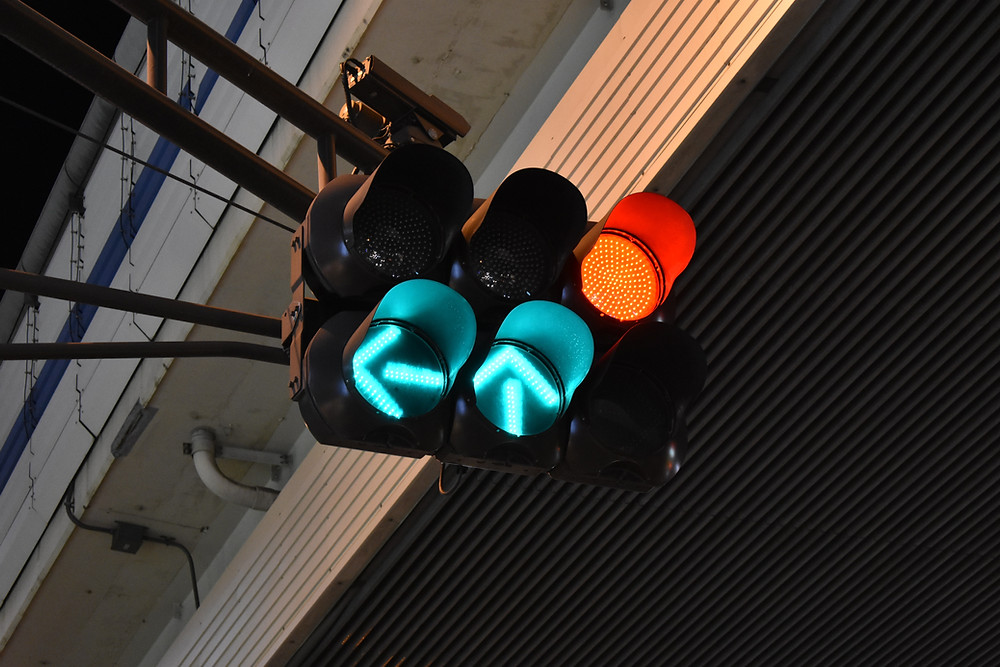 Traffic lights showing green arrows.