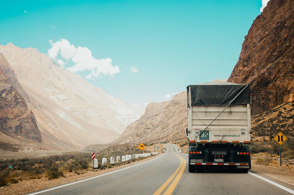 Truck driving through mountains.