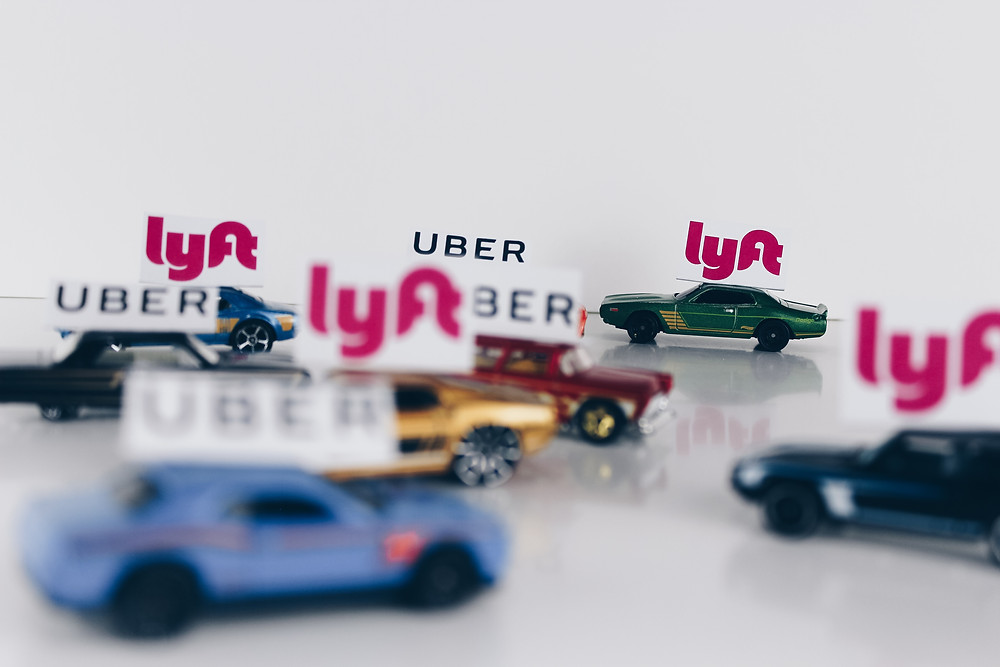 Toy cars marked with Uber and Lyft tags