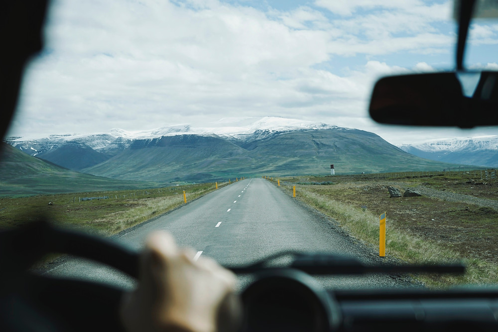 Driving down a deserted road in Iceland
