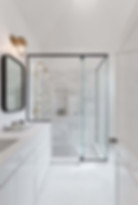 Custom glass shower with a semi-frameless design. Combines modern and traditional glass showers