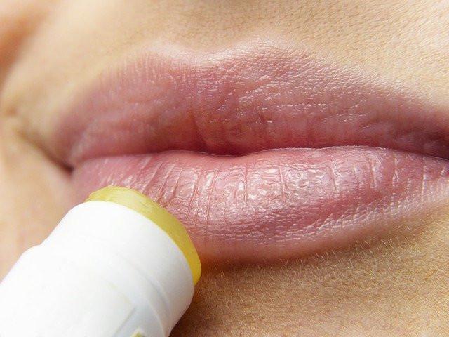 putting-chapstick-on-dry-lips