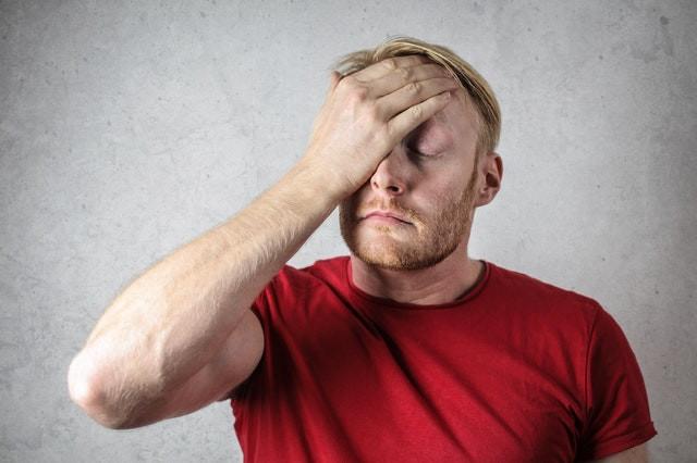 man-with-headache-feeling-fatigued