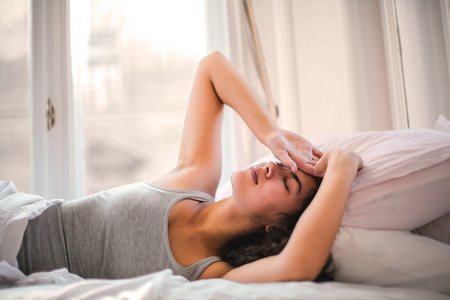 woman-sick-in-bed
