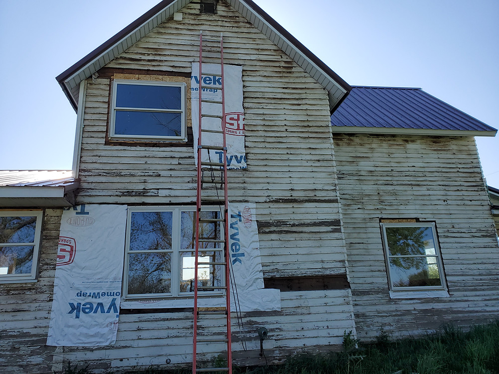 A photo of a dilapidated old house.