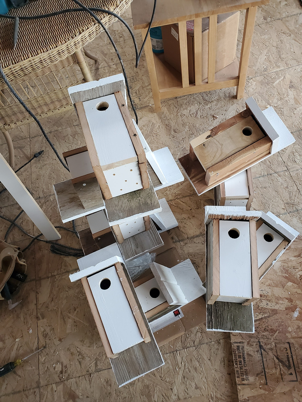 Carefully stacked bird houses wait to move to the field.