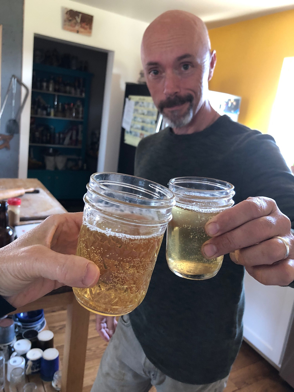 The author toasts with a glass of hard cider.