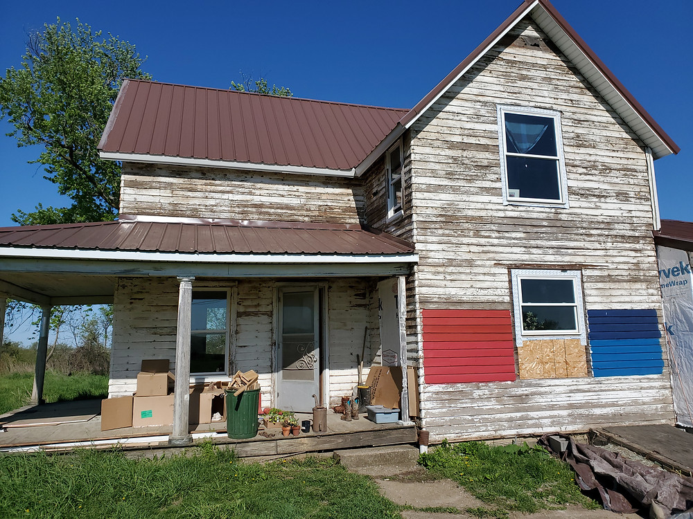 A picture of the house with 4 different colors, one of them Salty Dog blue.