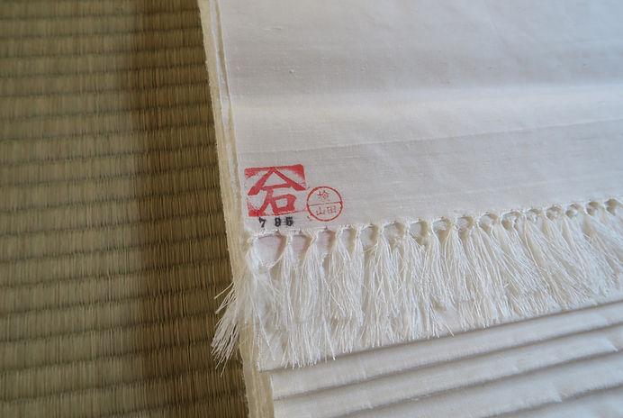 改石手織り