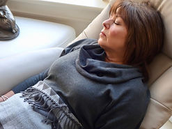 Client relaxing during hypnotherapy session