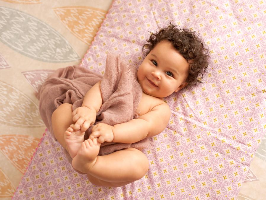 happy baby first birthday milestone session