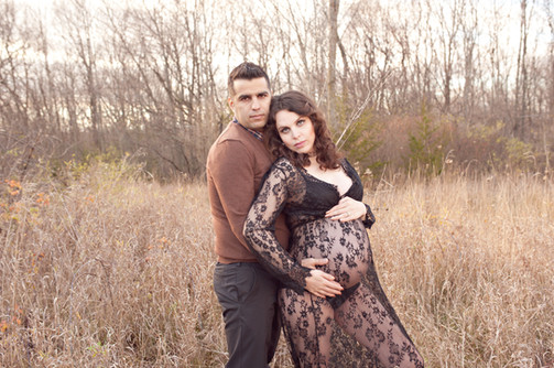maternity couple outside fall expecting family