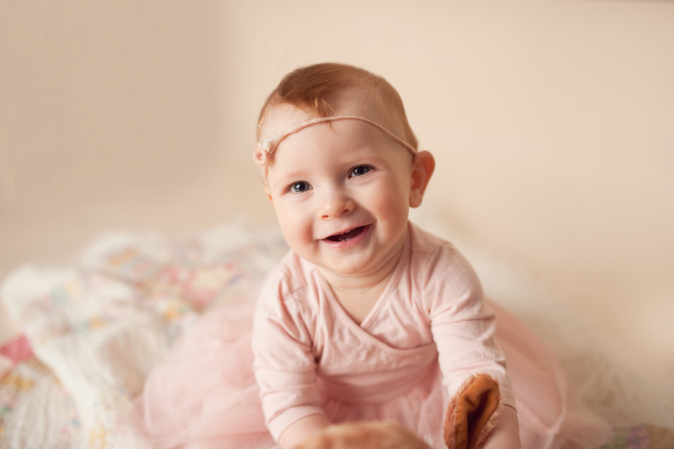 happy 6 month milestone sitter session neutrals pink red hair tieback beautiful tone