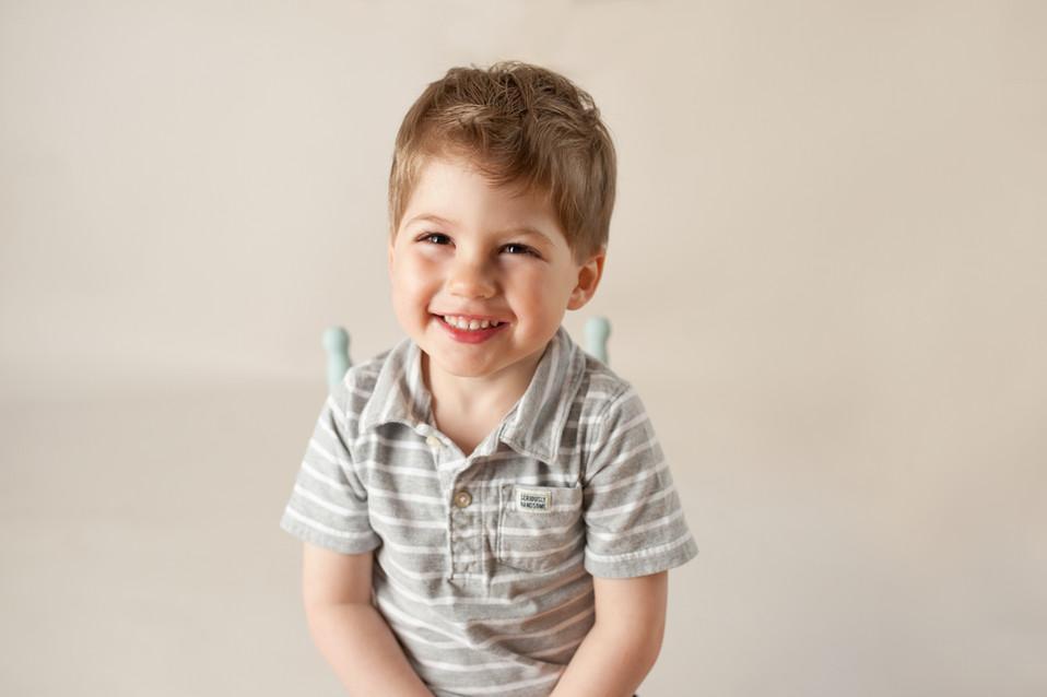2 years birthday smile in studio happy little chair prop
