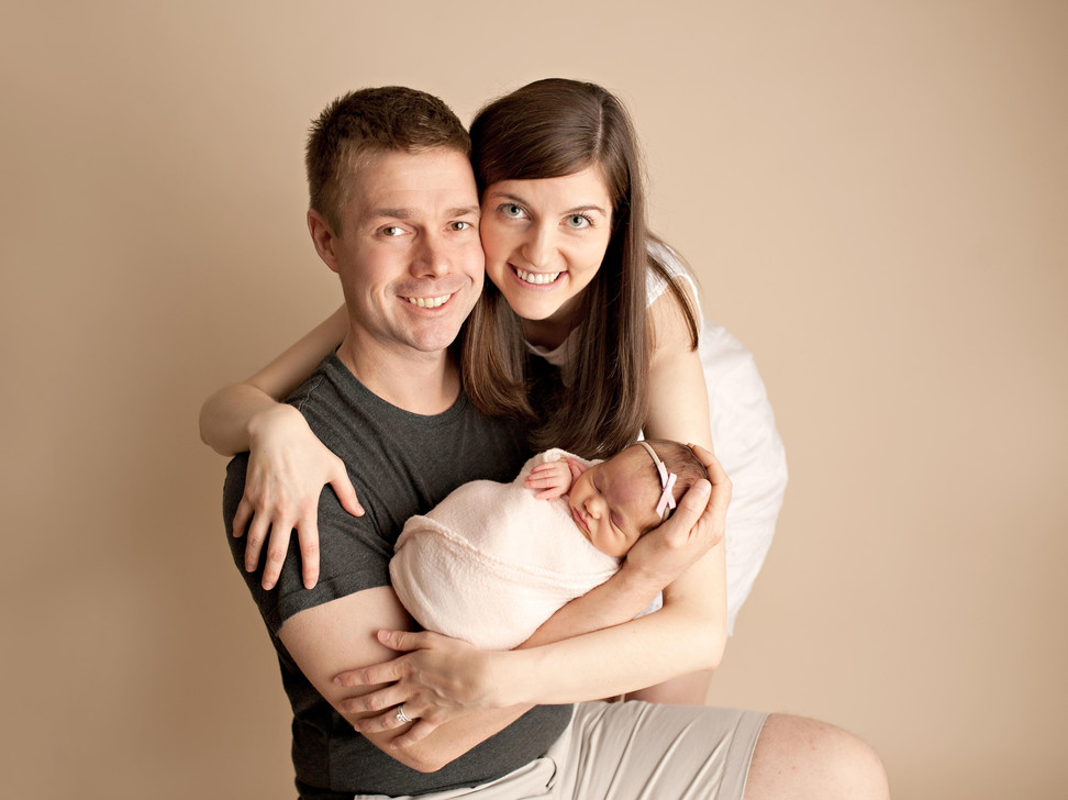 first baby newborn girl couple in studio family of 3